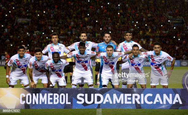 Players of Colombia's Junior de Barranquilla pose for pictures before the start of the Sudamericana Cup first leg quarterfinal football match against...
