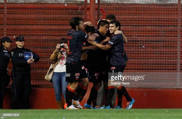Players of Colon celebrate the second goal of their team scored by Geronimo Poblete during a match between Argentinos Juniors and Colon as part of of...