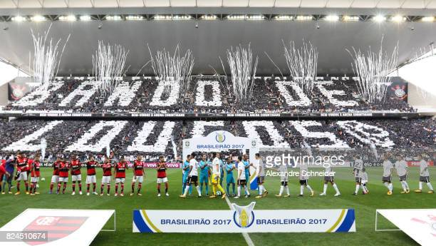 Players of Corinthians and of Flamengo stand for the national anthen before the match between Corinthians and Flamengo for the Brasileirao Series A...