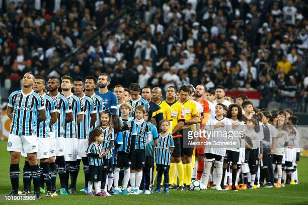 Players of Corinthians and of Gremio stand for the national anthen before the match for the Brasileirao Series A 2018 at Arena Corinthians Stadium on...