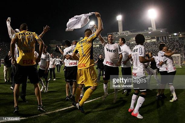 Players of Corinthians celebrate a title after the second leg of the final of the Copa Libertadores 2012 between Boca Juniors of Argentina and...