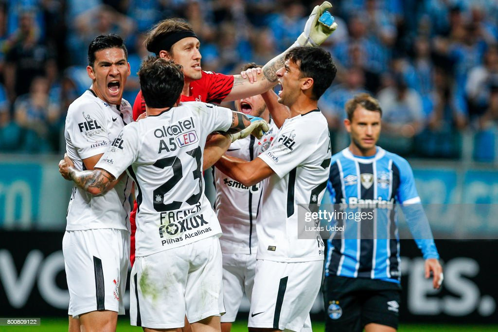 Players of Corinthians celebrate after the goalkeeper Cassio defendes a penalty kick of Gremio during the match Gremio v Corinthians as part of Brasileirao Series A 2017, at Arena do Gremio on June 25, 2017, in Porto Alegre, Brazil.