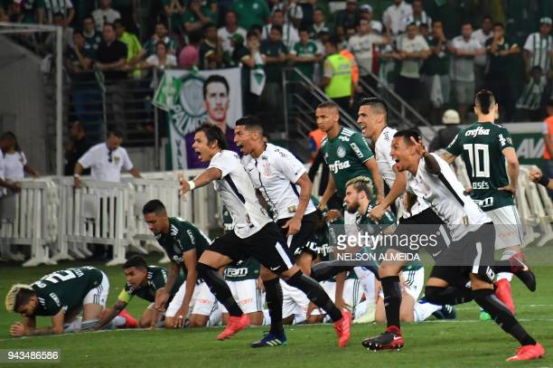 Players of Corinthians celebrate after their team won the 2018 Paulista championship final football match against Palmeiras held at Allianz Parque...