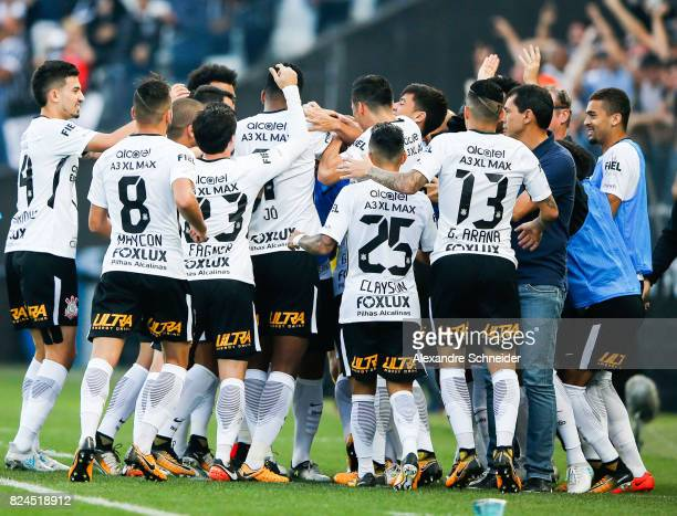 Players of Corinthians celebrate their first goal during the match between Corinthians and Flamengo for the Brasileirao Series A 2017 at Arena...