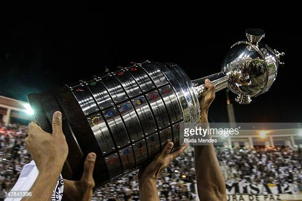Players of Corinthians hold up the trophy during the celebration of the title after the second leg of the final of the Copa Libertadores 2012 between...