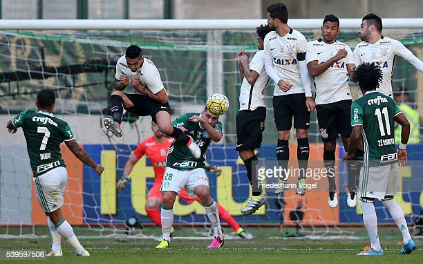 Players of Corinthians jumps in the wall during a free kick from Dudu of Palmeiras during the match between Palmeiras and Corinthians for the...