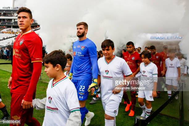 Players of Corinthins and of Fluminense enter the fiield before the match between Corinthinas and Fluminense for the Brasileirao Series A 2018 at...