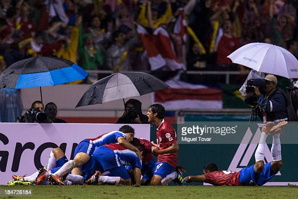 Players of Costa Rica celebrates after a goal during a match between Costa Rica and Mexico as part of the CONCACAF Qualifiers at National Stadium on...