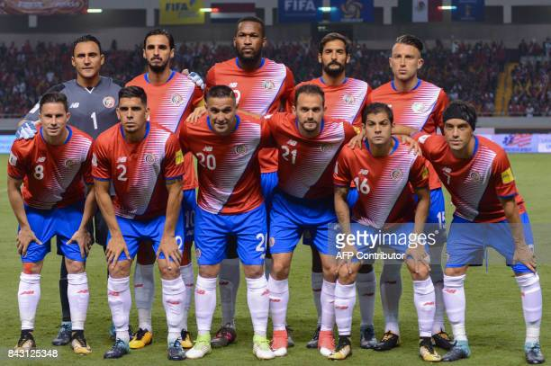Players of Costa Rica pose for pictures before the start of their 2018 World Cup football qualifier match against Mexico in San Jose on September 5...