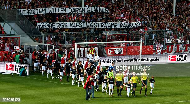 Players of Cottbus and Nuernberg walk on the pitch during the Bundesliga Play Off match between FC Energie Cottbus and 1.FC Nuernberg at the Stadion...