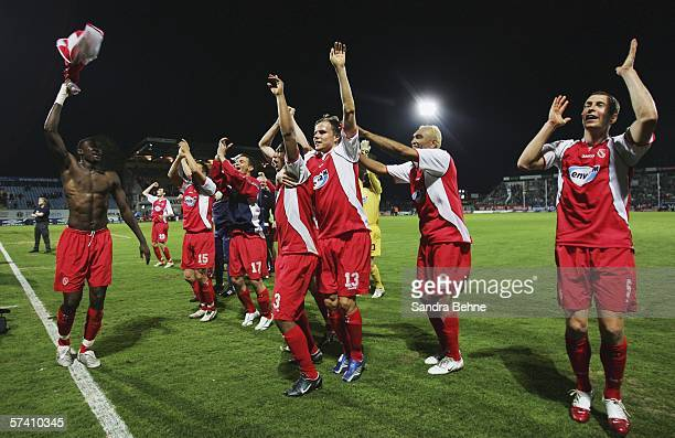 Players of Cottbus celebrate after the Second Bundesliga match between Spvgg Greuther Furth and Energie Cottbus at the Playmobil Stadium on April 24...