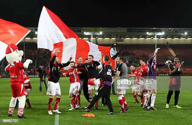 Players of Cottbus celebrate after winning the Second Bundesliga match between FC Energie Cottbus and 1.FC Union Berlin at Stadion der Freundschaft...