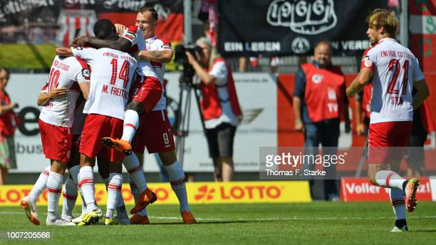 Players of Cottbus celebrate during the 3. Liga match between FC Energie Cottbus and F.C. Hansa Rostock at Stadion der Freundschaft on July 29, 2018...