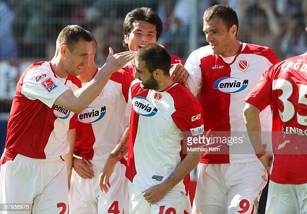 Players of Cottbus jubilate after team mate Stiven Rivic scored the second goal during the Bundesliga match between FC Energie Cottbus and Bayer 04...