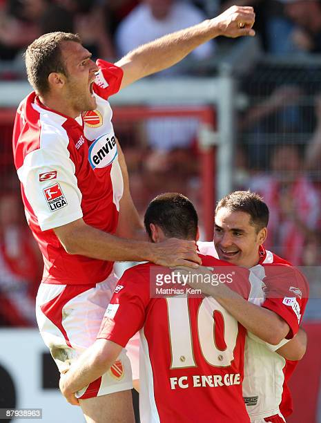 Players of Cottbus jubilate after team mate Stiven Rivic scoring the second goal during the Bundesliga match between FC Energie Cottbus and Bayer 04...