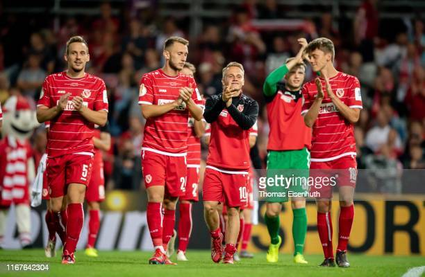 Players of Cottbus leave the stadium after the DFB Cup first round match between Energie Cottbus and FC Bayern Muenchen at Stadion der Freundschaft...