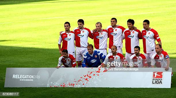 Players of Cottbus pose prior to the Bundesliga Play Off match between FC Energie Cottbus and 1.FC Nuernberg at the Stadion der Freundschaft on May...