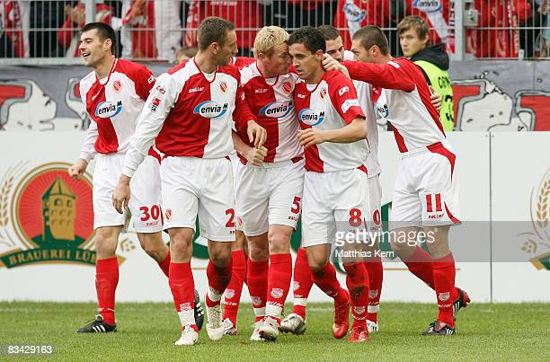 Players of Cottbus show their delight after Dimitar Rangelov scoring the first goal during the Bundesliga match between FC Energie Cottbus and...