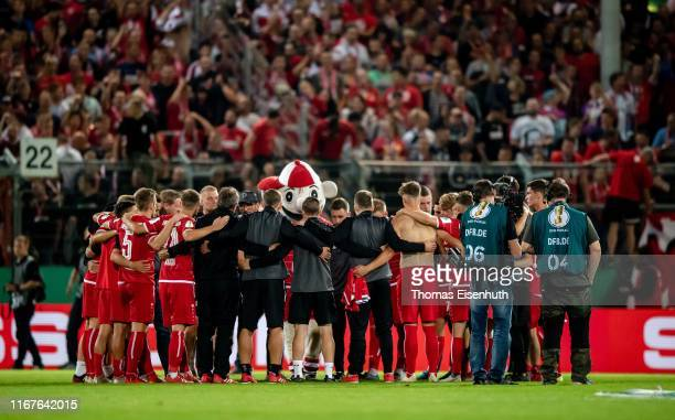 Players of Cottbus stay together after the DFB Cup first round match between Energie Cottbus and FC Bayern Muenchen at Stadion der Freundschaft on...