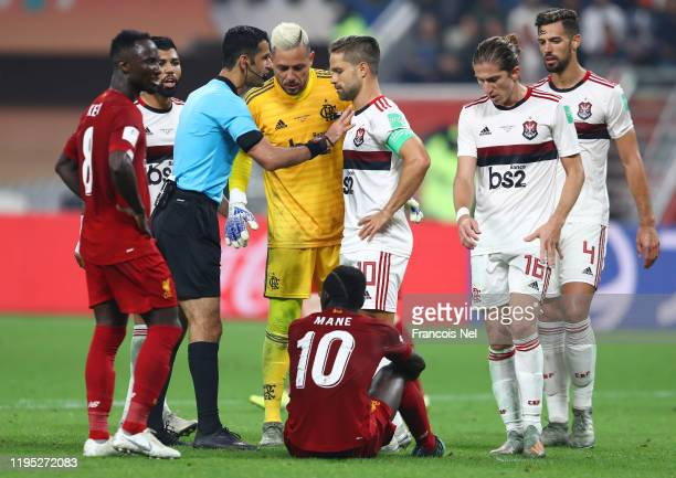 Players of CR Flamengo confront referee Abdulrahman Al Jassim after a foul is awarded on Sadio Mane of Liverpool and penalty given however it is...