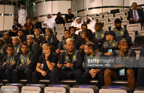 Players of CR Flamengo watch the match from the stands during the FIFA Club World Cup 2nd round match between Al Hilal and Esperance Sportive de...