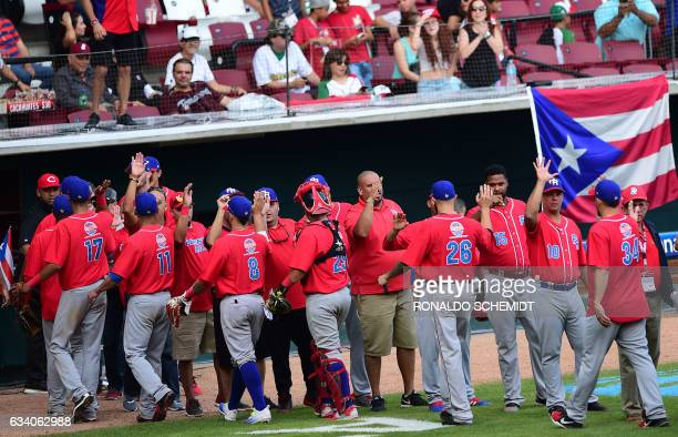 Players of Criollos de Caguas of Puerto Rico celebrate after winnning the Caribbean Baseball Series semifinal match against Aguilas del Zulia of...