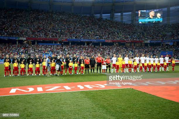 Players of Croatia and Denmark line up ahead of the 2018 FIFA World Cup Russia Round of 16 match between Croatia and Denmark at the Nizhny Novgorod...
