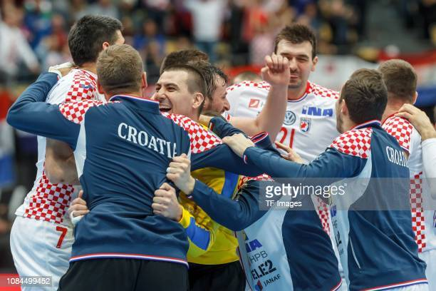 Players of Croatia celebrate after winning after the 26th IHF Men's World Championship group B match between Spain and Croatia at Olympiahalle on...
