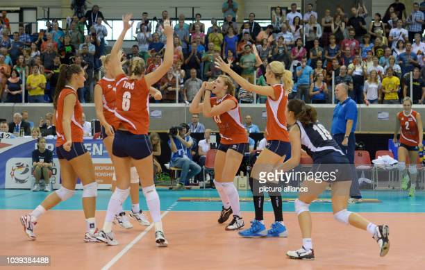 Players of Croatia celebrate after winning the women's CEV Volleyball European Championship Group C match between Belarus and Croatia at the...