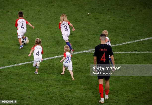 Players of Croatia celebrate with their kids after the 2018 FIFA World Cup Russia Semi Final match between England and Croatia at Luzhniki Stadium on...