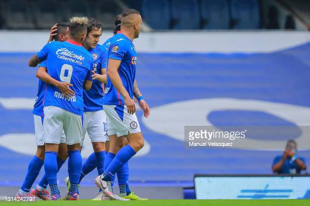 Players of Cruz Azul celebrate the first scored goal by Elías Hernández of Cruz Azul during the 16th round match between Cruz Azul and Atletico de...