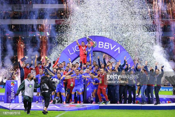 Players of Cruz Azul celebrate with the trophy after winning during the Final second leg match between Cruz Azul and Santos Laguna as part of the...