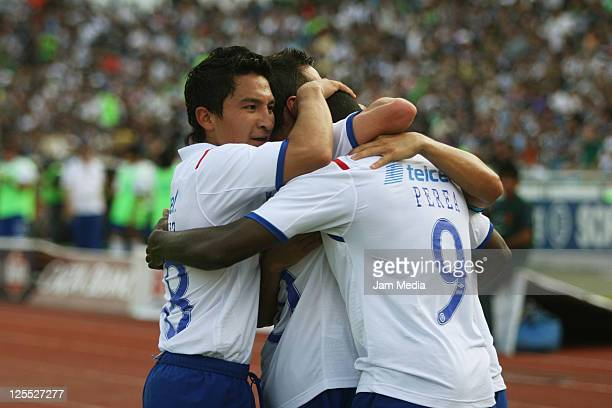 Players of Cruz Azul celebrates a scored goal during a match as a part of the Apertura 2011 Tournament in the Mexican Football League at Tecnologico...