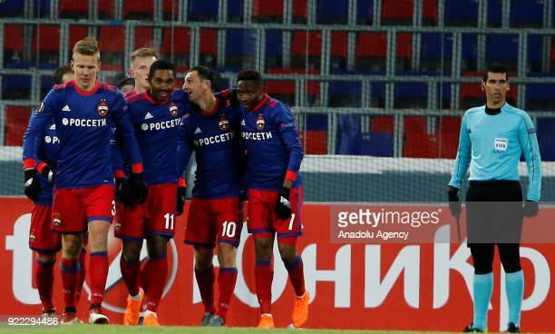 Players of Crvena Zvezda and players CSKA Moscow vie for the ball during the UEFA Europa League round of 32 second leg soccer match between CSKA...