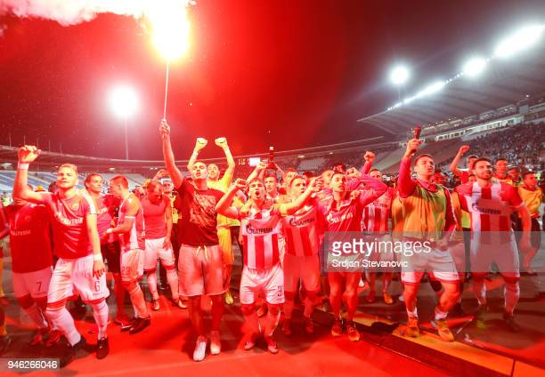 Players of Crvena Zvezda celebrate after the Serbian Super League Play Off match between FK Crvena Zvezda and Partizan at the stadium Rajko Mitic on...