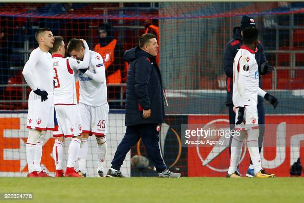 Players of Crvena Zvezda react after losing the UEFA Europa League round of 32 second leg soccer match against CSKA Moscow at the Stadium CSKA Moscow...