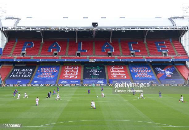 Players of Crystal Palace and Southampton take a knee in support of the Black Lives Matter movement prior to the Premier League match between Crystal...
