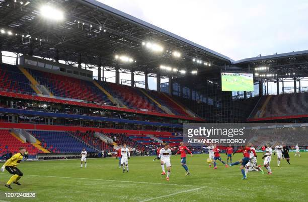 Players of CSKA football fight for the ball with players of Ufa team during their Russian Premier league football match at the VEB Arena in Moscow on...
