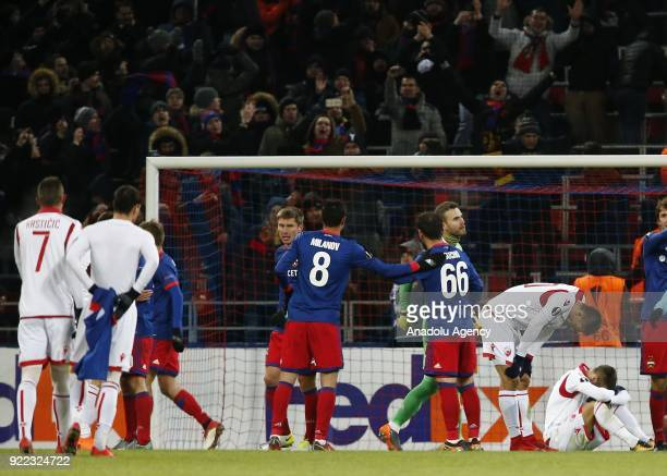 Players of CSKA Moscow celebrate after winning the UEFA Europa League round of 32 second leg soccer match against Crvena Zvezda at the Stadium CSKA...