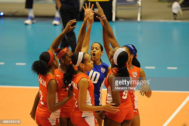 Players of Cuba celebrate a point during the match between Cuba and Serbia during the FIVB Women's Volleyball World Cup Japan 2015 at Park Arena...