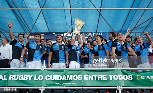 Players of CUBA celebrate after wining the final match of the URBA Top 14 between Hindu Club and CUBA at CASI Stadium on October 26, 2013 in Buenos...