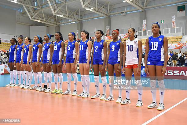 Players of Cuba line up for national anthem in the match between Cuba and Algeria during the FIVB Women's Volleyball World Cup Japan 2015 at Momotaro...