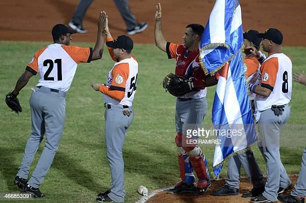 Players of Cuba's Azucareros de Villa Clara celebrate after defeating Puerto Rico's Indios de Mayaguez after their 2014 Caribbean baseball series...