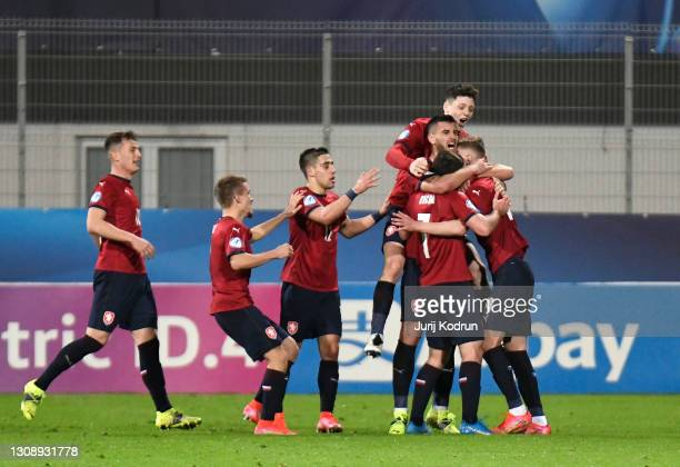 Players of Czech Republic celebrate after Giulio Maggiore of Italy scores an own goal during the 2021 UEFA European Under-21 Championship Group B...
