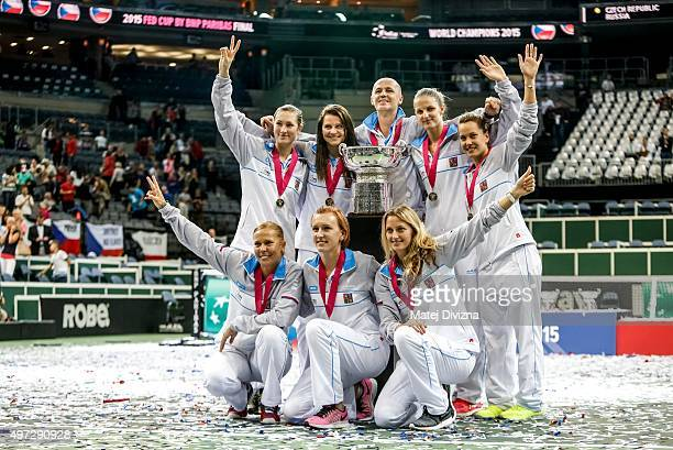 Players of Czech Republic pose for photographers as they celebrate their win after the Fed Cup final match between Czech Republic and Russia at O2...