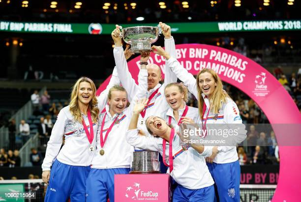 Players of Czech Republic team celebrate with their trophy after winning the Fed Cup final tennis match between Czech Republic and the United States...