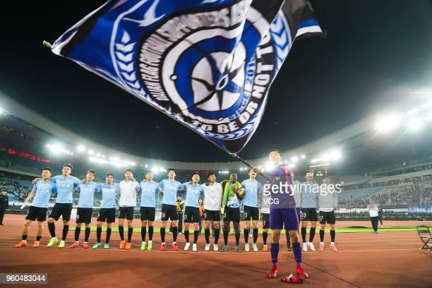 Players of Dalian Yifang celebrate after 2018 China Super League 11th round match between Dalian Yifang FC and Guizhou Hengfeng FC at Dalian Sports...