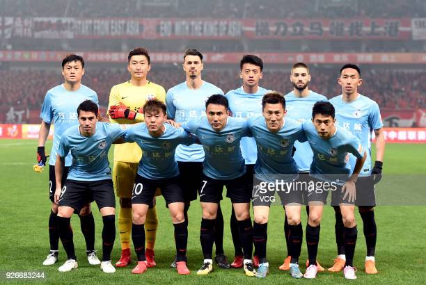 Players of Dalian Yifang line up prior to the 2018 Chinese Football Association Super League first round match between Shanghai SIPG and Dalian...
