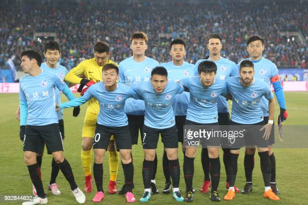 Players of Dalian Yifang line up prior to the 2018 Chinese Football Association Super League third round match between Dalian Yifang and Beijing...