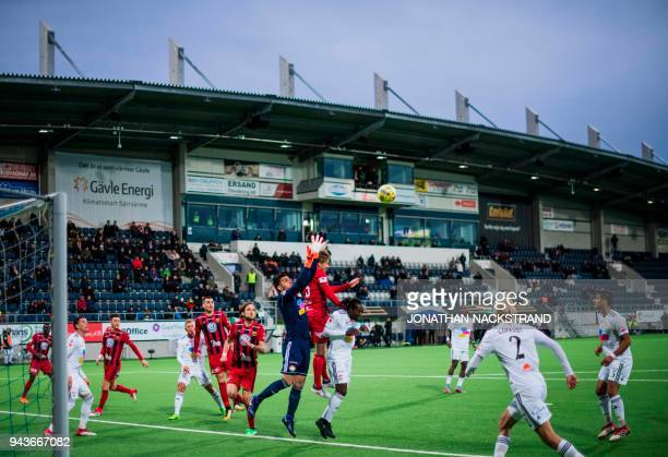 Players of Dalkurd FF fight for the ball with players of Östersund during the Swedish top division league match on April 8 2018 in Gävle Sweden...